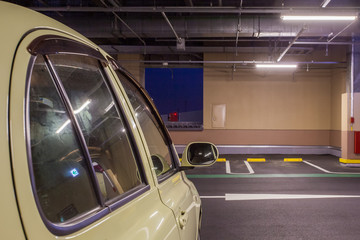 Parking garage underground interior, neon lights in dark .