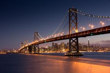Dusk over San Francisco-Oakland Bay Bridge and San Francisco Skyline. Yerba Buena Island, San Francisco, California, USA.