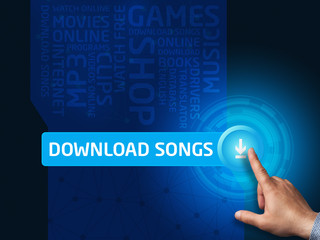 Download songs.Businessman presses a button on the virtual scree