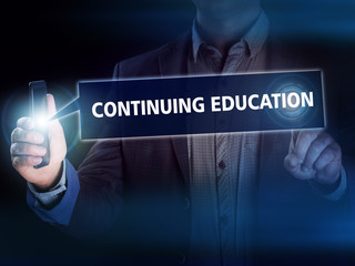 Businessman presses button continuing education on virtual scree