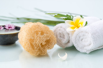 Spa concept with Floating Flowers, Loofah, and towel