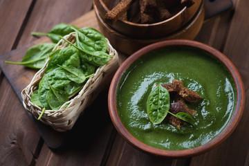 Freshly made spinach cream soup, studio shot, close-up