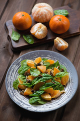 Salad with spinach, mandarins and walnuts, studio shot