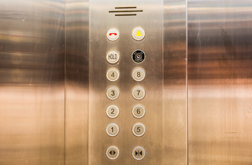 Stainless steel elevator panel push buttons.