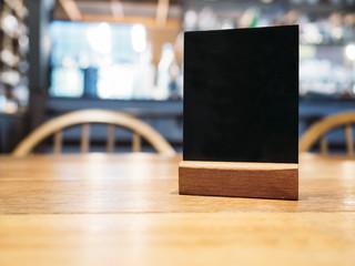Mock up Menu frame on Table in restaurant cafe