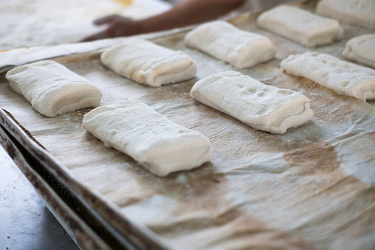 Tray of Freshly Prepped Ciabatta Rolls Buns