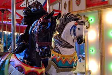 Brightly Painted Horses on an Antique Carousel.