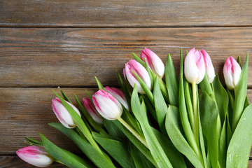 bunch of fresh tulips on wooden boards