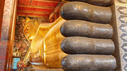 The Reclining Buddha at  Wat Pho (Pho Temple) in Bangkok, Thailand