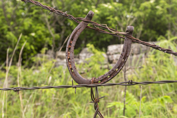 horseshoe used as a fence tightener for barbed wire, Kansas