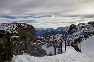 Snowy mountain landscape under a dramatic sky