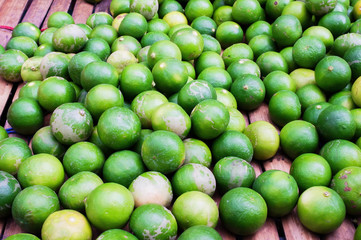Heap of lime on bamboo stall selling  in market