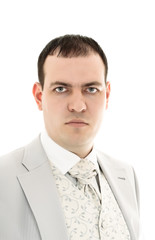 serious young man in wedding suit portrait