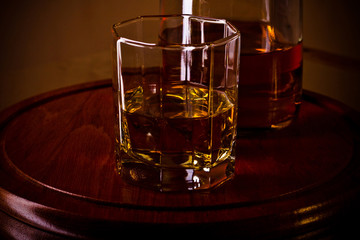 whiskey glass on wooden tray