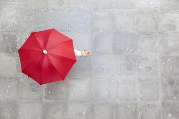 Obraz Man holding a red umbrella - fototapety do salonu
