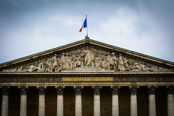 Detail of front facade of Assemblee Nationale building in Paris