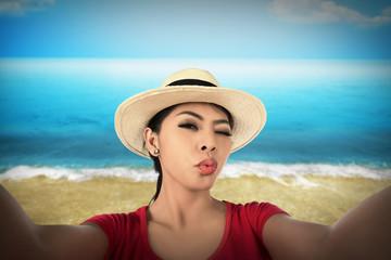 Woman take selfie on the beach