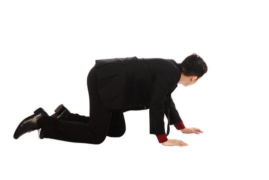 Asian Business Man Crouching