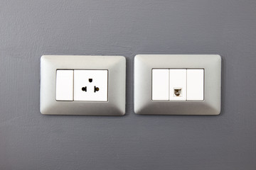 electric plug and network ethernet port on wall