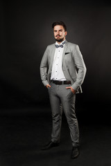 handsome guy with beard and mustache in suit