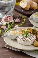 Grilled camembert with mini herbs baguettes