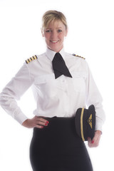 Attractive female airline pilot standing in uniform