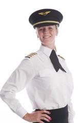 Attractive female airline pilot standing in uniform