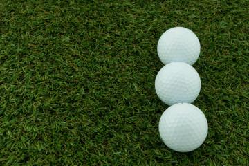 Three golf ball on grass, Closeup shoot.