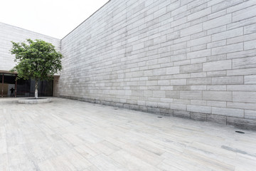 white brick wall and empty sandstone road