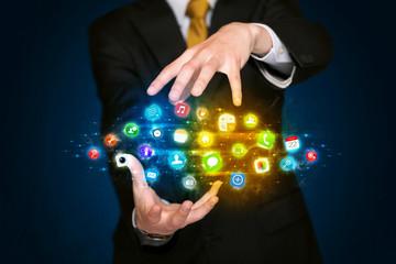 Businessman holding app icon cloud