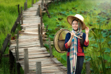 Asian woman traditional dress.farmer go to work in countryside.The simple life.