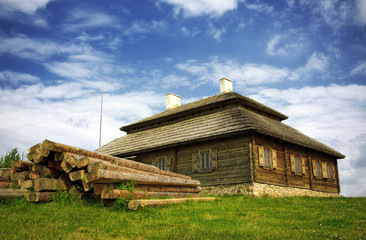 wooden cottage on green hill