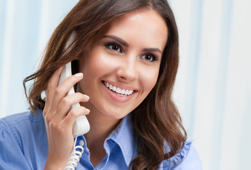 businesswoman or customer support phone female worker, at office