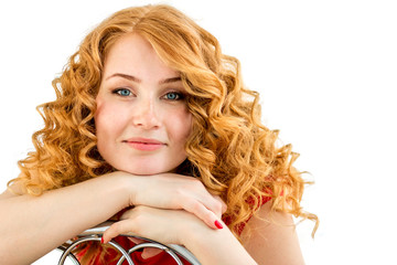 the red-haired blue-eyed girl with freckles and curly hair