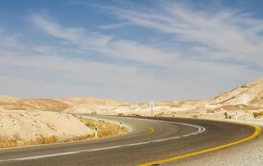 Beautiful road in the desert .
