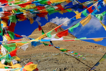 Buddhist prayer flags over Smira La-mountain pass. Tibet. 1566