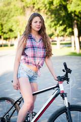 Girl sitting on bicycle