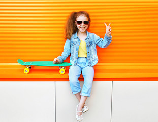 Fashion kid. Stylish little girl child wearing a jeans clothes a