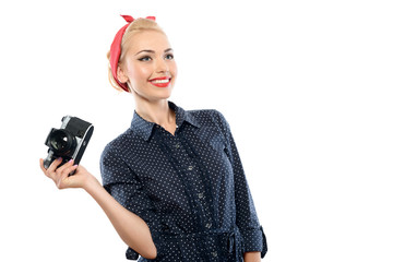 Pin up girl with a camera