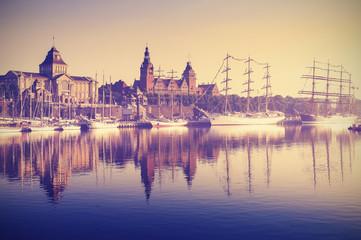 Obraz Vintage style picture of sailing ships in Szczecin at sunrise, Poland. - fototapety do salonu