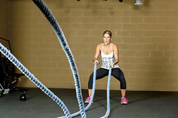 Female Using Training Ropes
