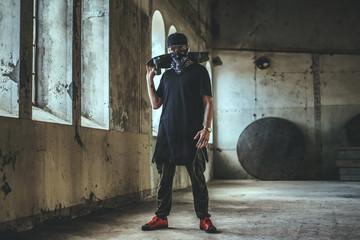 Gangsta skater in mask with skateboard. Wall mural