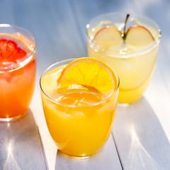 Fresh fruit juice from oranges apples pink grapefruit