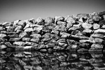 Rock wall protection from the waves - toned image