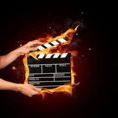 Man with film clapper in fire