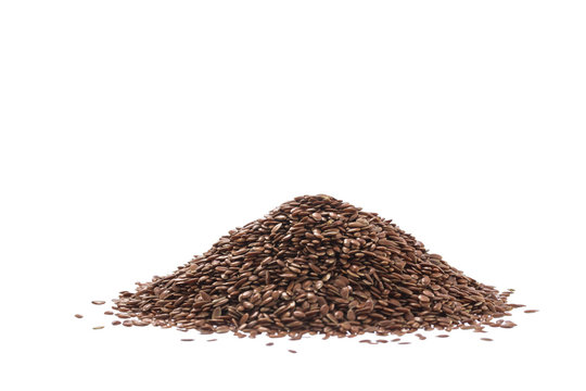 Pile of brown flax seed or linseed isolated on white background