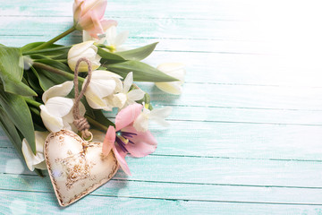 Background with tulip flowers and heart