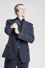 Business Concept: Young Caucasian Businessman in Blue Suit Speak