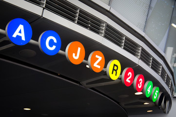 New York City Subway lines (A, C, J, Z, R, 2, 3, 4, 5) listed at the entrance to Fulton Center hub station in the Financial District.
