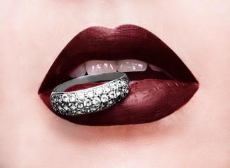 Beautiful red glossy lips close-up, macro photography